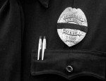 Police officer badge with black band