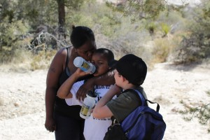 Lacy kissing her son's cheek on a desert trail